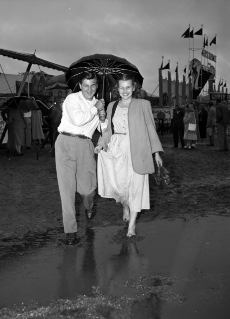 Couple at flooded Fair.