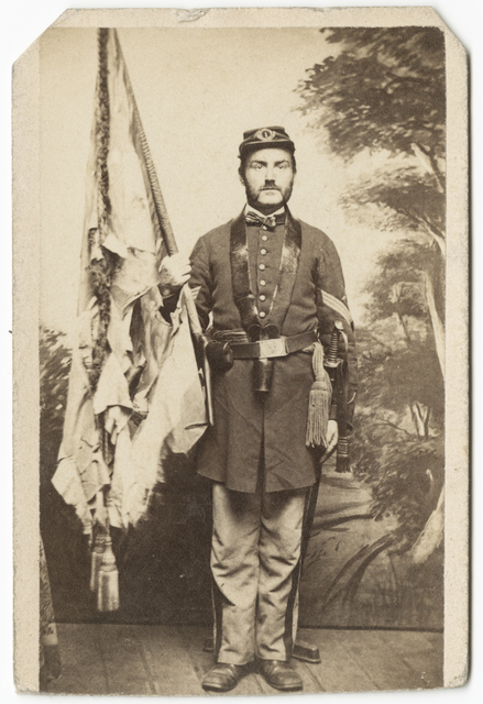 Sergeant William Irvine holding First Minnesota battle flag
