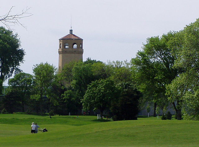 Highland Park Water Tower behind treeline.