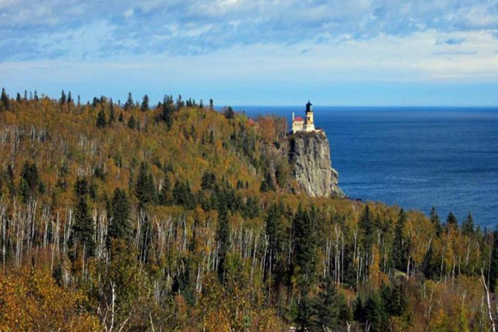 The lighthouse and the cliff visible from afar. Similar to 5 but further away and from a higher spot.