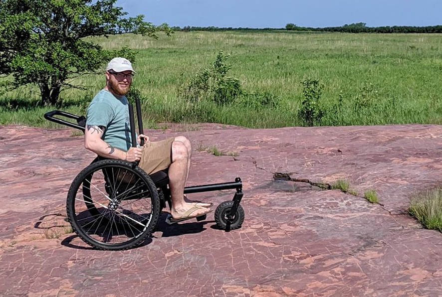 Man in a grit wheelchair at Jeffers Petroglyphs.