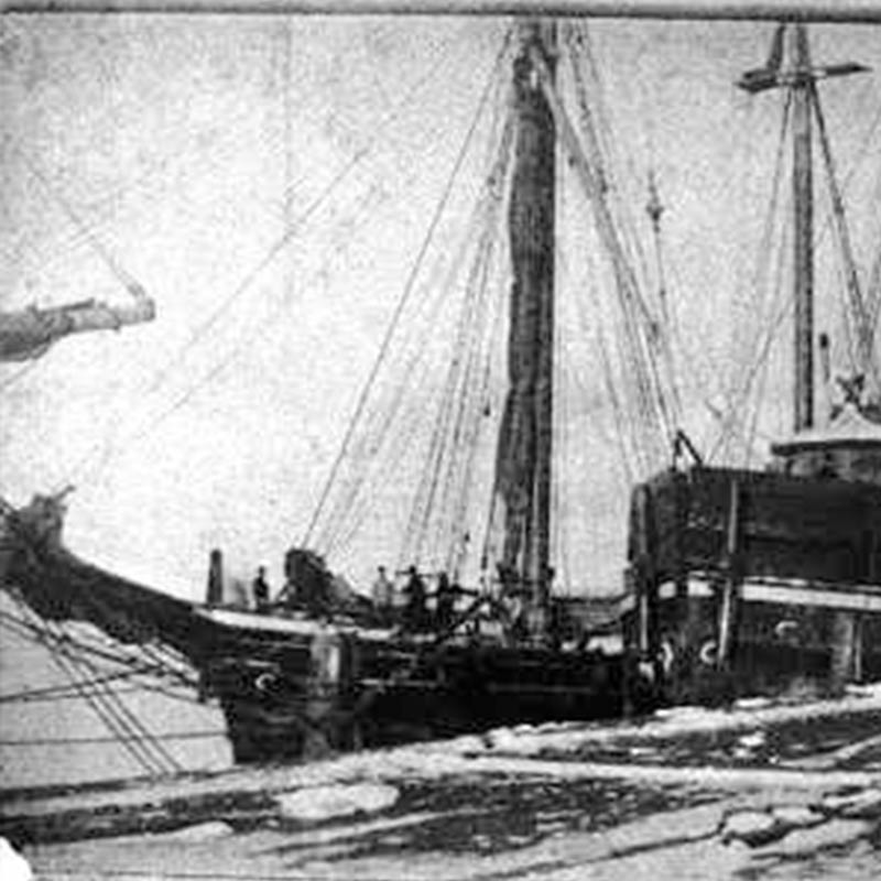 Grainy image of a schooner in icy water