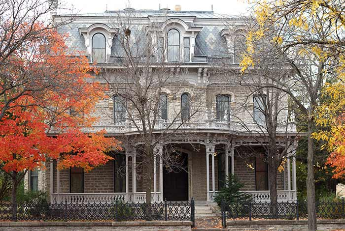 Exterior view of Alexander Ramsey House entrance, with orange and yellow leaves