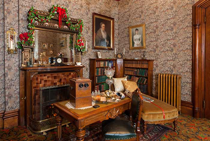 Study in Alexander Ramsey House, with Christmas garland around the mirror