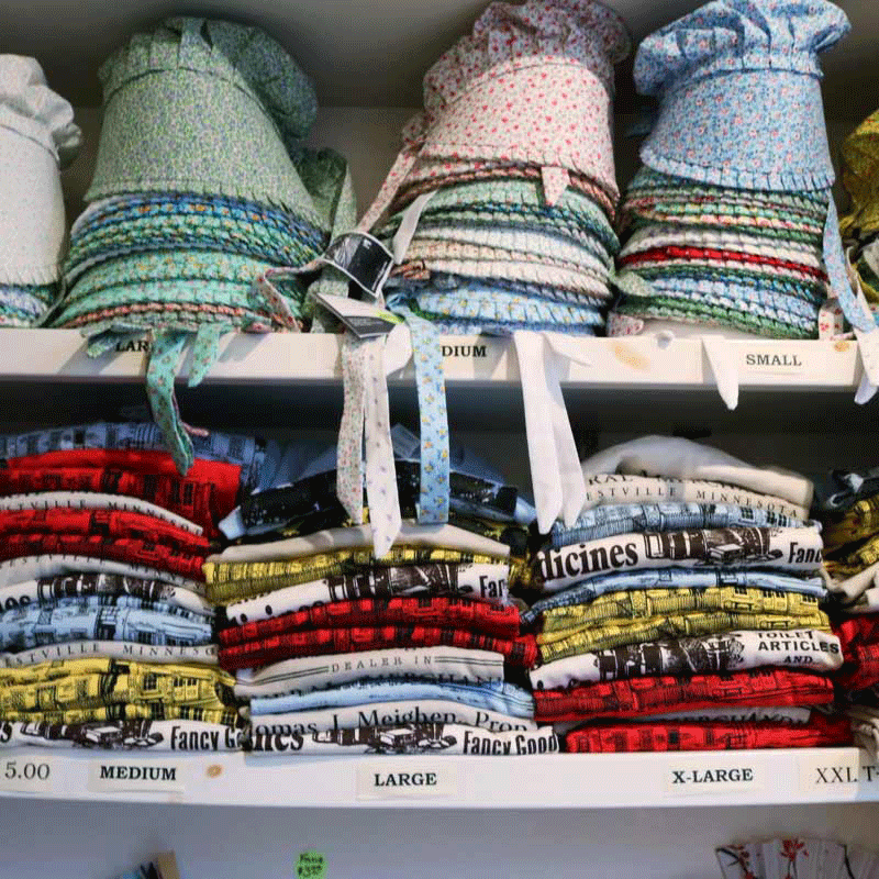 Shelves of bonnets for sale in the gift shop.