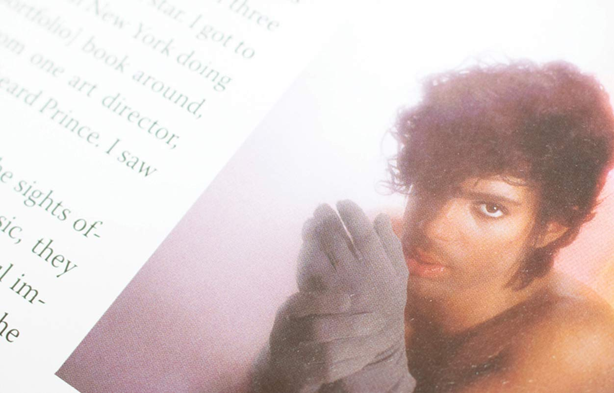 Page from book with photo of Prince wearing gloves.