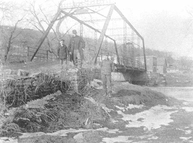 A man and two boys pose in front of the Forestville bridge, circa 1900. Source: MNHS Collections.