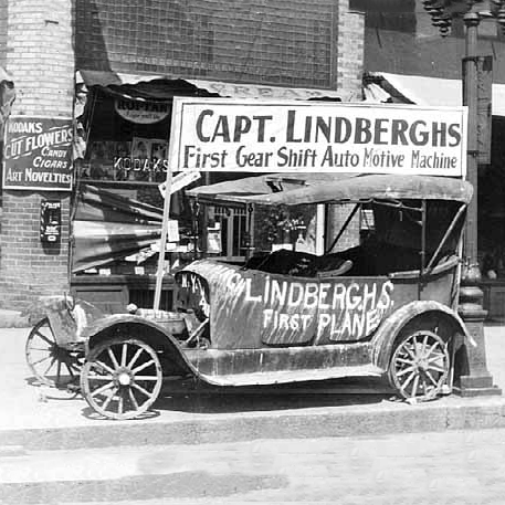 """Lindbergh's first plane,"" Captain Lindbergh's first gear shift automotive machine, part of Lindbergh visit festivities. Source: MNHS Collections."