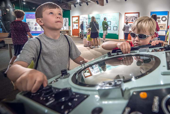 A child using a simulator in the visitor center