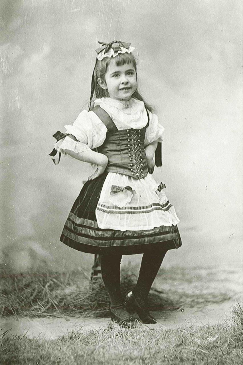 Portrait of young Charlotte posing in a fancy dress