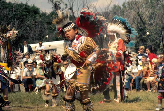 Child dressed in regalia dancing at a Shakopee Mdewakanton Sioux Community powwow, 1970. Source: MNHS Collections.