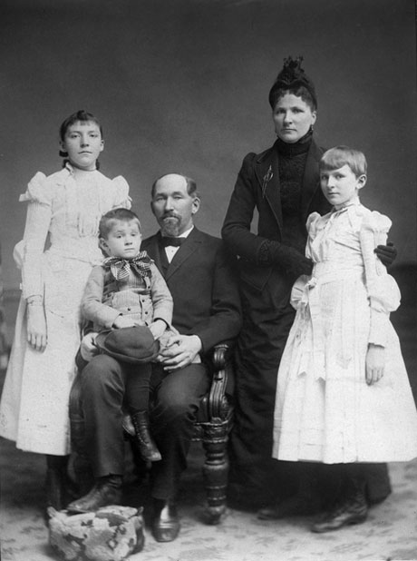 Solomon G. and Sarah A. Comstock with their children: Ada, George and Jessie.