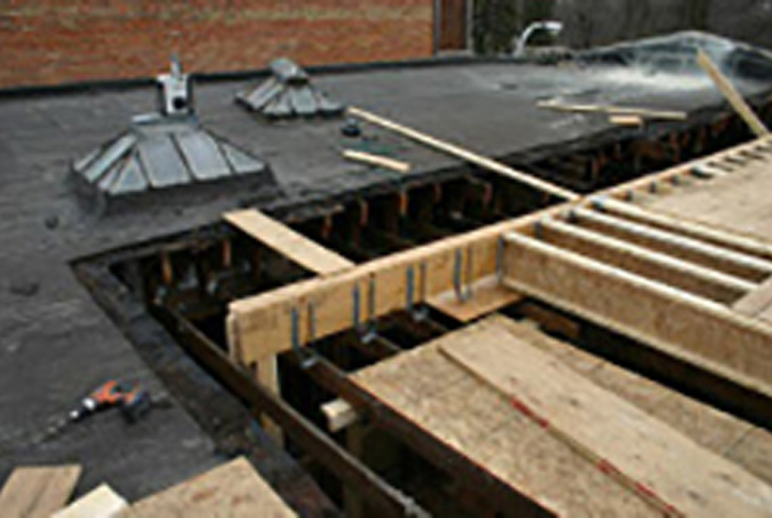 Photo of a roof construction project.