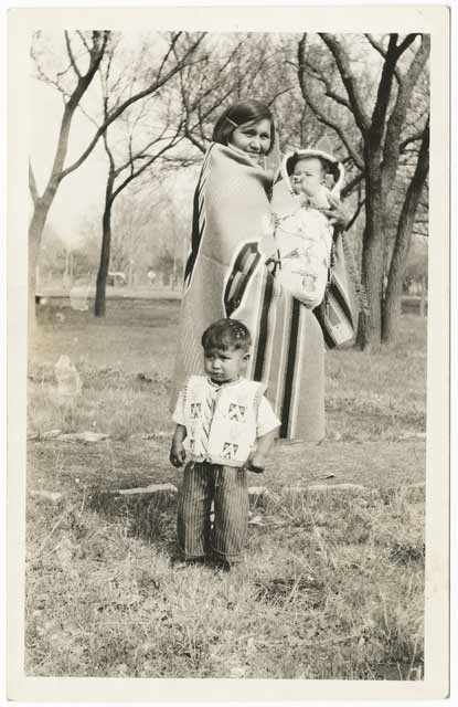 A Dakota woman and her children, about 1920. Source: MNHS Collections.
