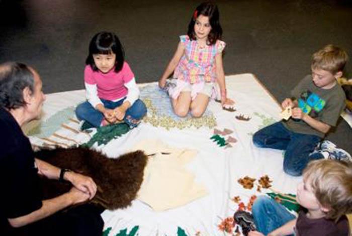 Children sitting in a circle.