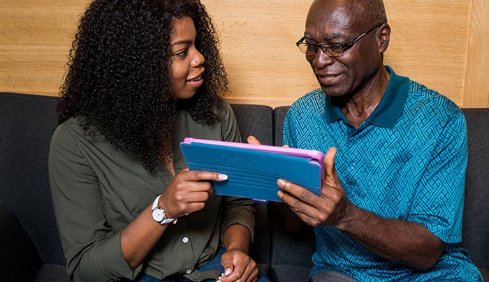 A woman showing the app to her relative.