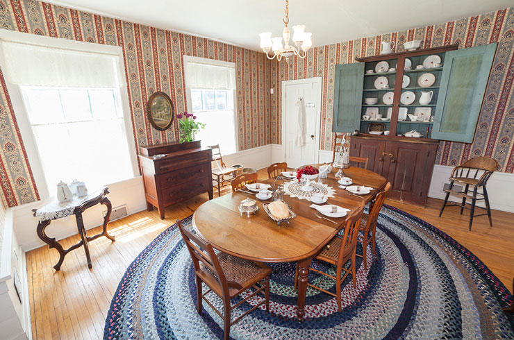 Dining room with a table set for four people.
