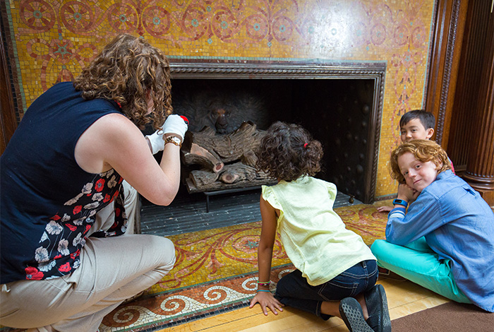 Guide showing children a fireplace