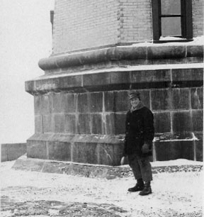 Franklin Covell standing in front of Split Rock Lighthouse in the winter