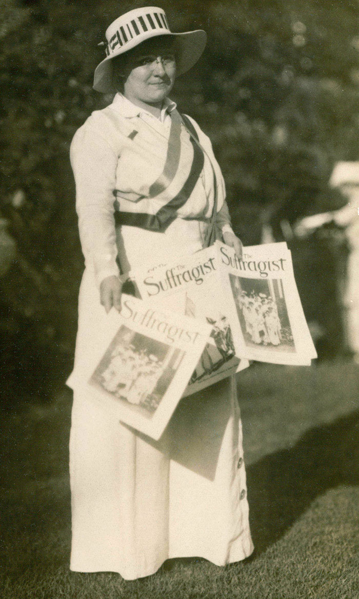 Gertrude Hunter distributing The Suffragist magazine, about 1916.