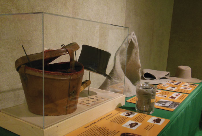 Table display with hat and artifacts.