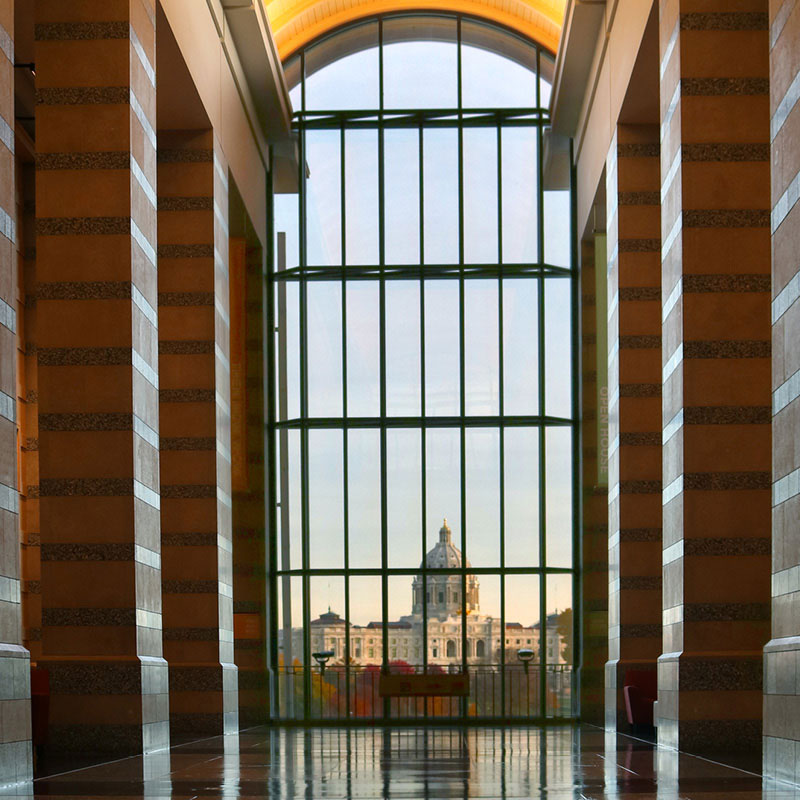 View of the Minnesota State Capitol from inside the Minnesota History Center.