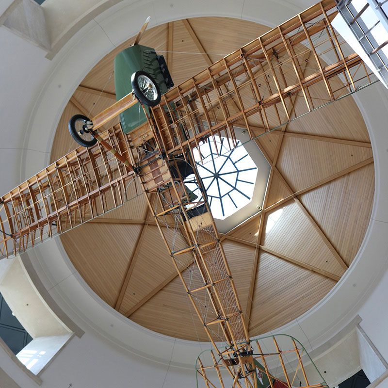 The Jenny airplane suspended from the ceiling of the Minnesota History Center.