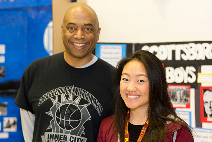 teacher standing with student