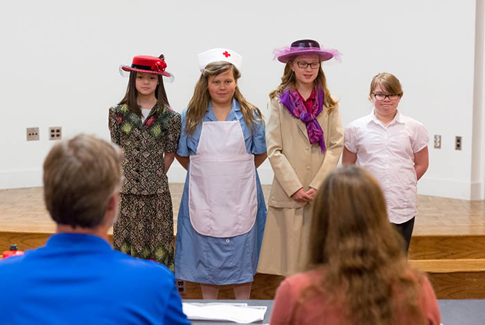Students wearing historic costumes.