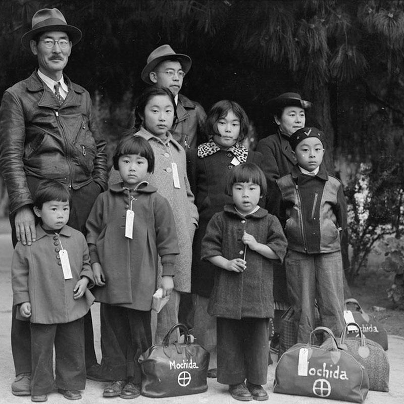 May 8, 1942 — Hayward, California. Members of the Mochida family awaiting evacuation bus.
