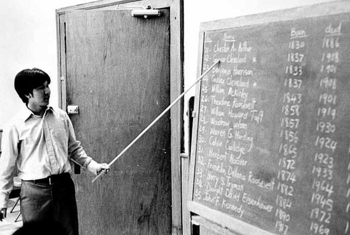 man in front of chalkboard