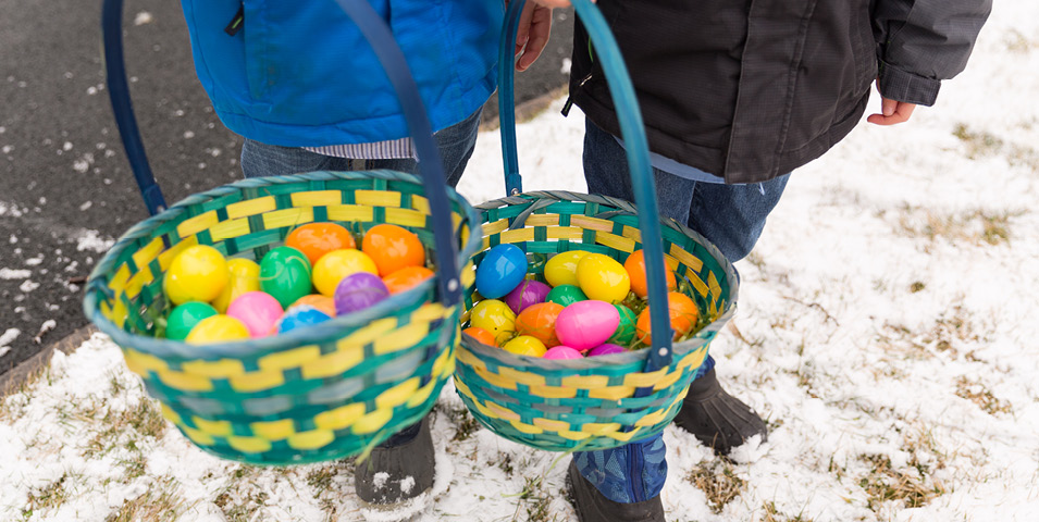 Two Easter egg baskets, which are full of Easter eggs