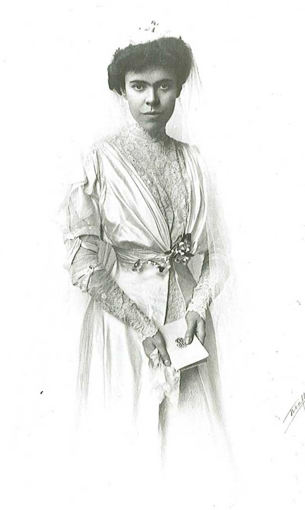 Portrait of a woman in a wedding dress, looking at the camera