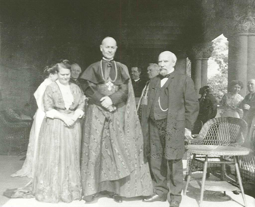 Mary T. and James J. Hill with a cleric on the Hill House veranda