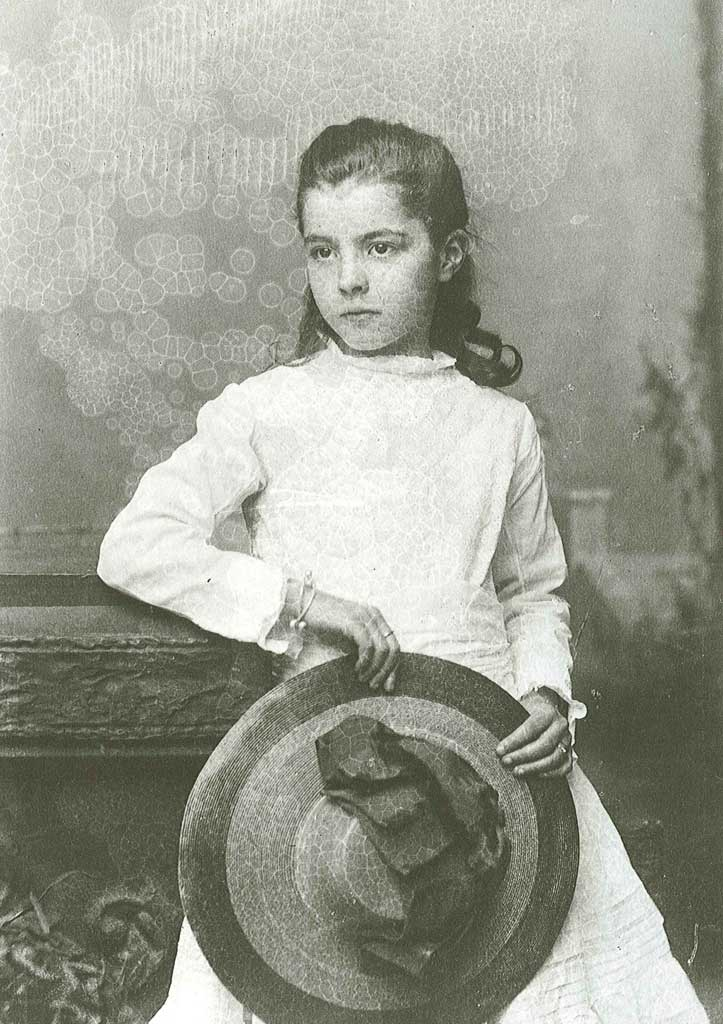 Portrait of young Ruth holding a hat