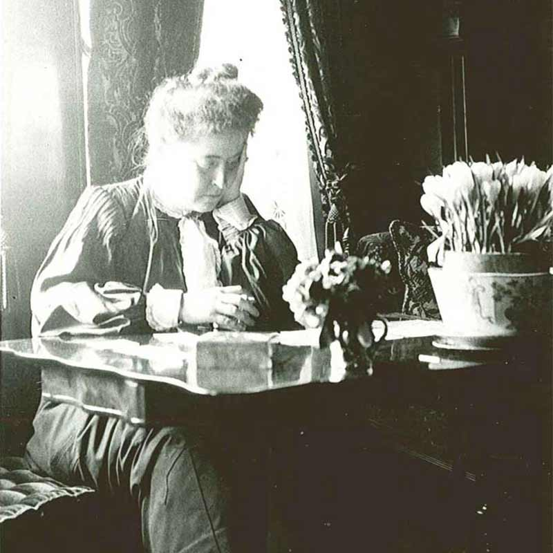 Charlotte Hill sitting at a desk
