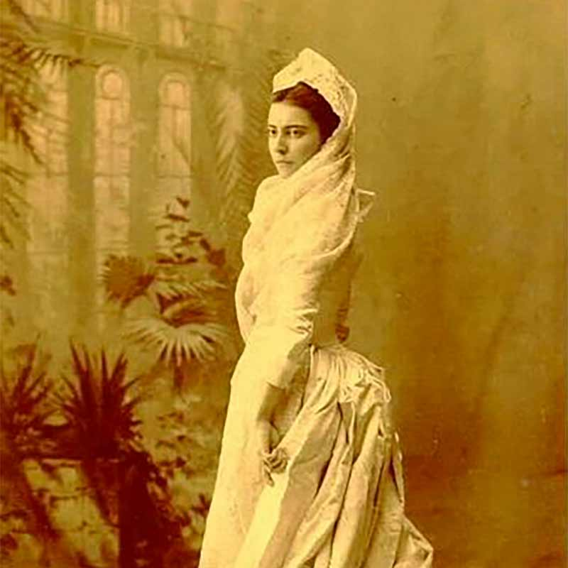 Mamie Hill facing left in her wedding dress