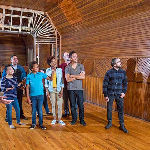 Group in large paneled room