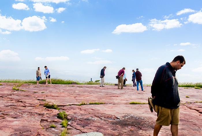 People looking at rock carvings.