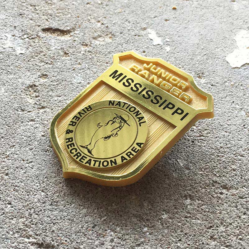 Badge with the words: Mississippi National River and Recreation Area. Junior Ranger Program.