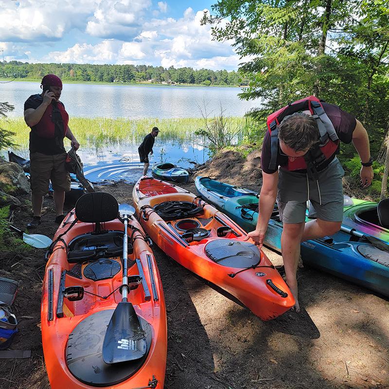 Kayaks on lakeshore.