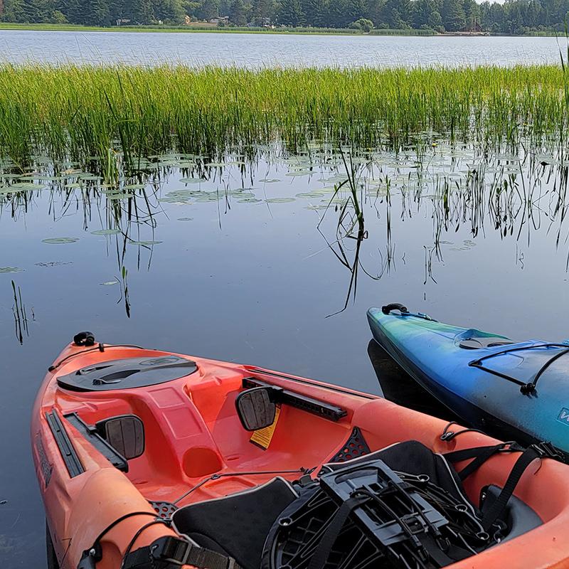 Kayaks on a lake.