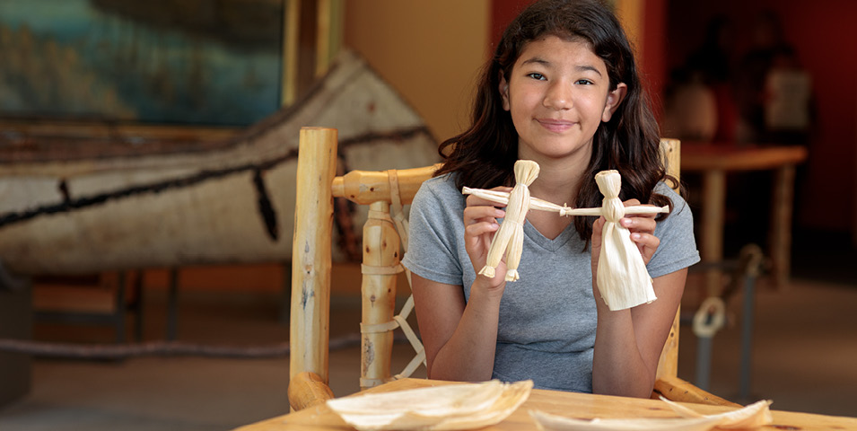A girl working on a craft.