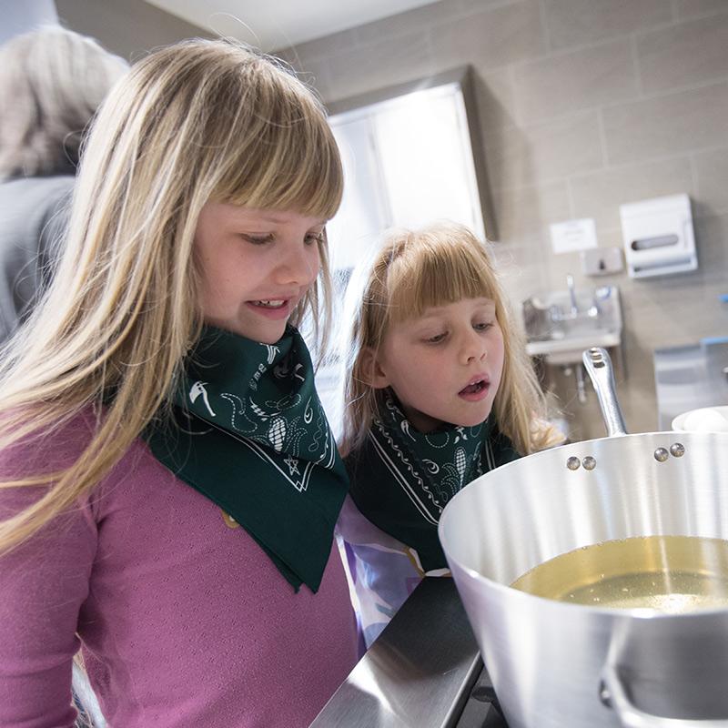 girls looking at pot