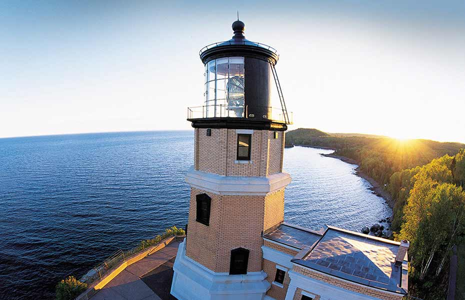 Lighthouse next to Lake Superior at sunset