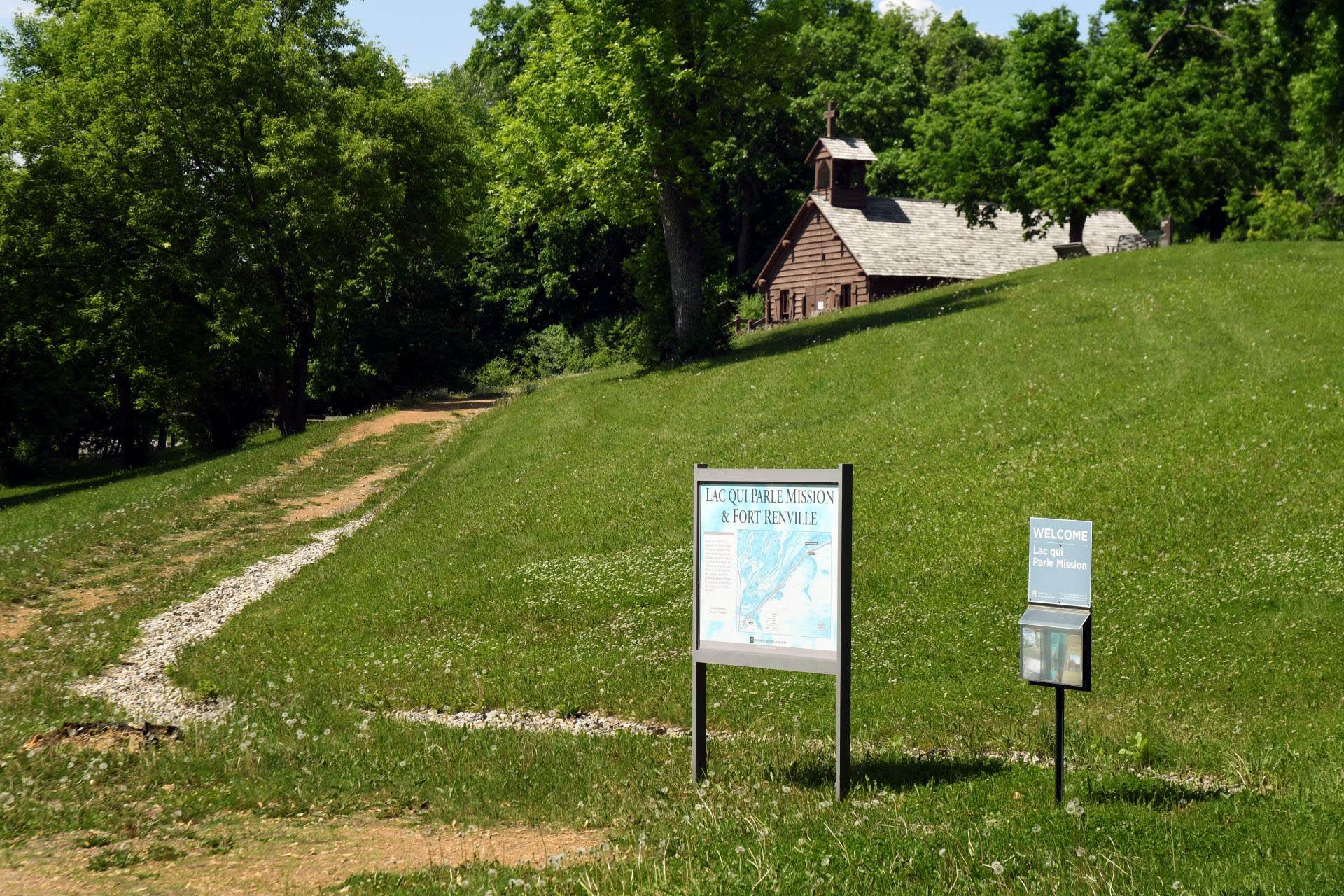 Trail leading towards a historic church.