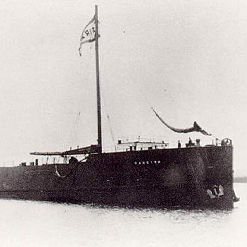 Grainy image of a barge at sea