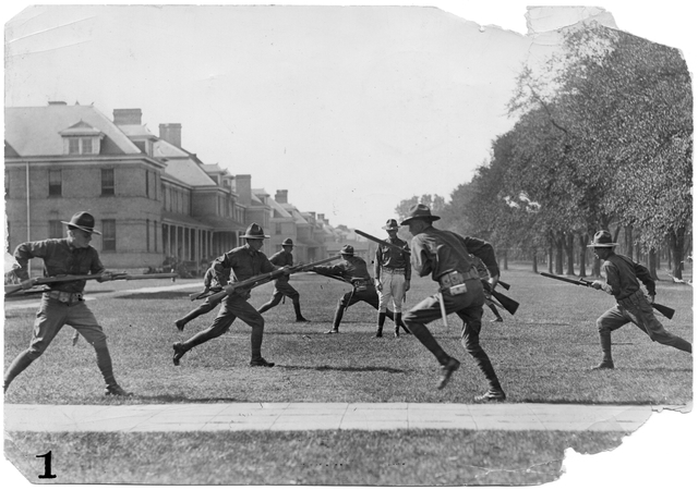 Bayonet drill in front of the officers' quarters, 1917. Source: MNHS Collections.