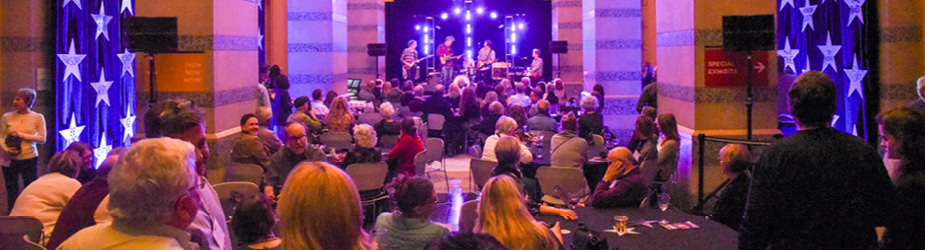 People listening to a band perform at the Minnesota History Center.