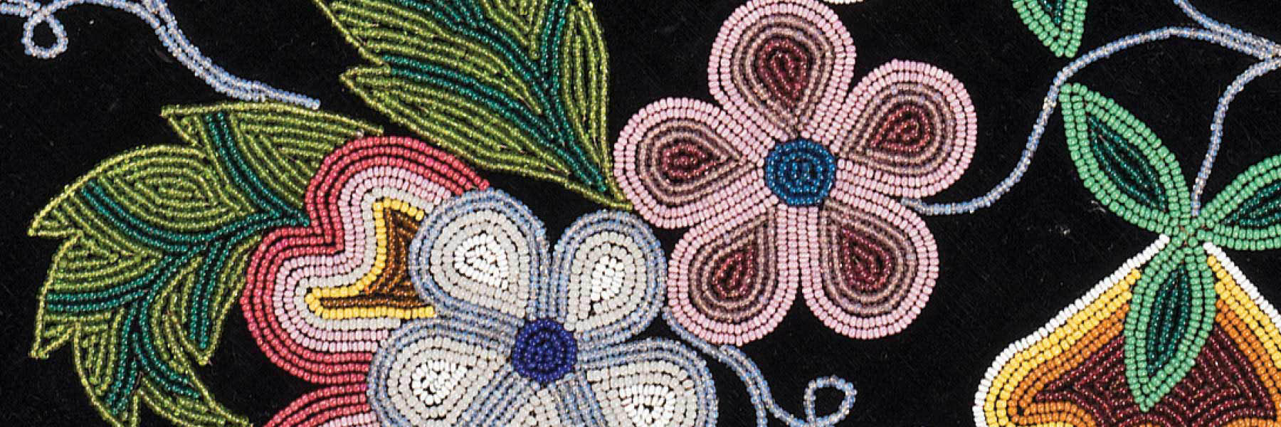Flower beadwork on black fabric.